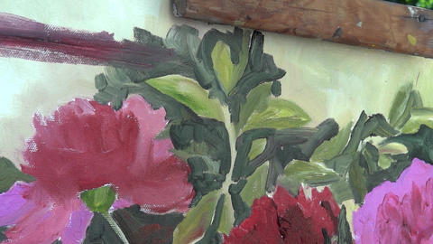 Hand of a painter, brush in hand, who paints with oil colors on canvas support.  ライブ動画