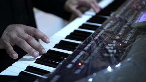 Hand to play piano keyboards 4a Footage