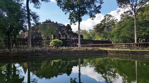 Water reflection Angkor Thom Cambodia ancient stone ruin temple Footage