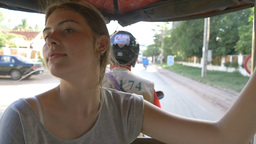 Backpacking young tourist girl traveling in tuk tuk in asia Cambodia Footage