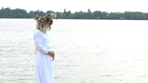 Beautiful Pregnant Young Girl With A Wreath On His Head Stay Near River Slow Footage
