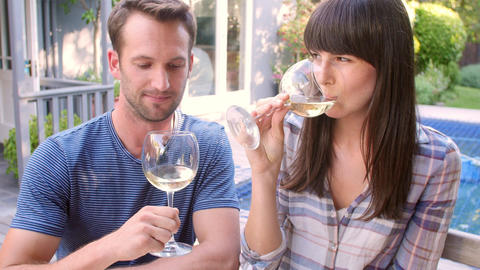 Couple Enjoying Outdoor Drinks In Garden Footage