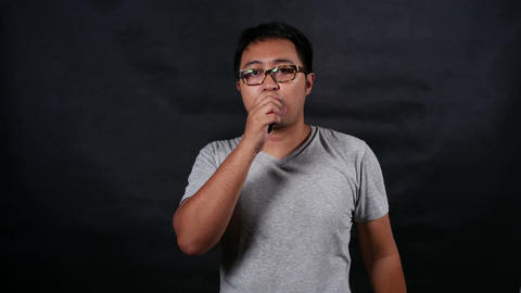 Man vaping electronic cigarette makes smoke clouds, guy smoking e-cig Footage