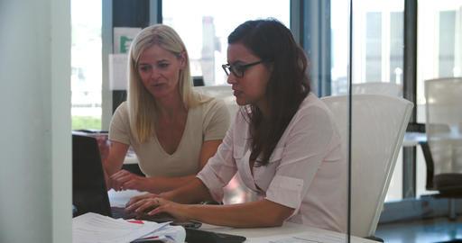 Businesswomen Working At Desks In Modern Open Plan Office Footage