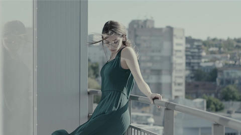 Woman Standing On A Balcony Slow Motion Footage
