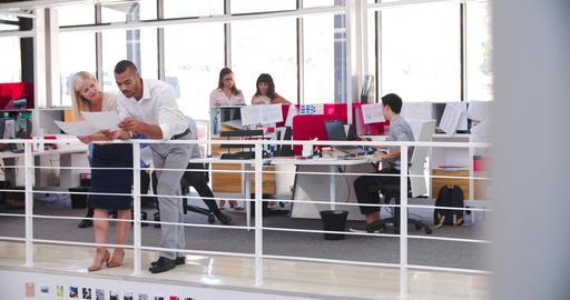 People Working At Desks In Modern Open Plan Office Footage