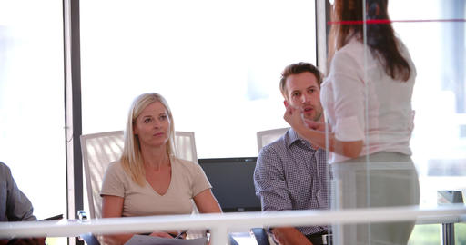 People Attending Business Meeting In Modern Open Plan Office Footage