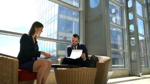 Two business people discussing documents Footage