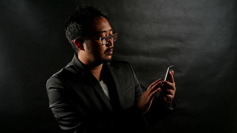Businessman man using smartphone Browsing and Text Messaging Footage