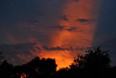 Beautiful unusual orange sunset フォト