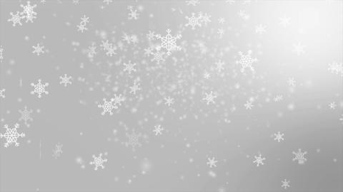 Falling snowflake over gray abstract background for winter promotion and christm Footage