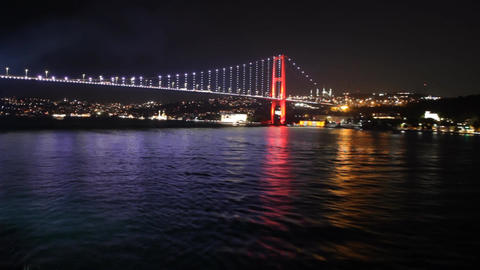 Sailing away from Istanbul's bridge at night Live Action