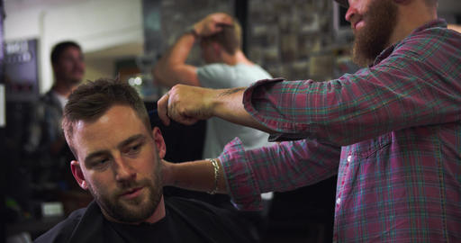 Male Barber Giving Client Haircut In Shop Live Action