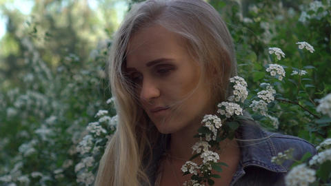 A Girl Smells Flowers In A Field Slow Motion Footage