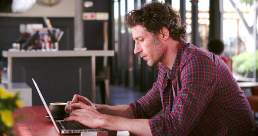 Mature Man In Cafe Working On Laptop Footage