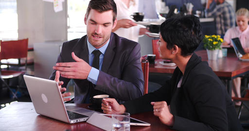 Two Businesspeople Having Meeting In Coffee Shop Live Action