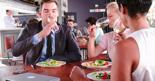 Three Businesspeople Having Lunch In Restaurant Live Action