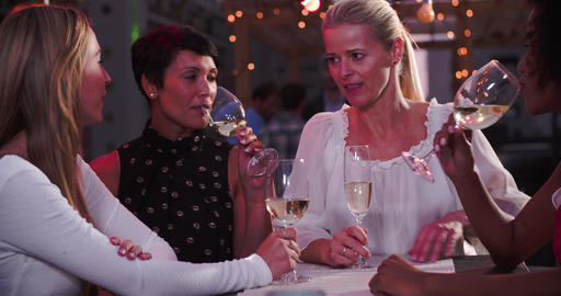Group Of Female Friends Relaxing Together At Rooftop Bar Live Action