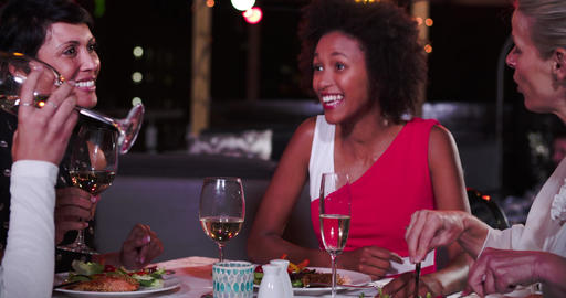 Group Of Female Friends Enjoying Meal At Rooftop Restaurant Live Action