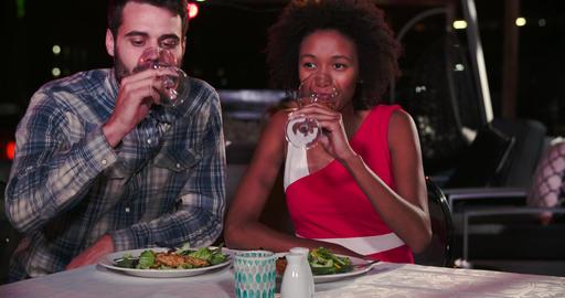 Young Couple Enjoying Meal At Rooftop Restaurant Footage