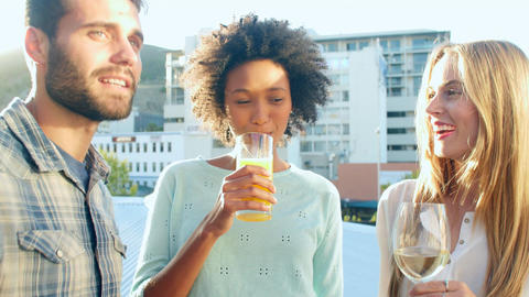 Group Of Friends Relaxing Together At Rooftop Bar Footage