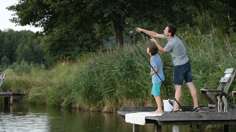 Hipster dad and boy enjoying fishing at the pond Footage