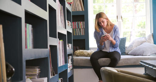 Woman Sitting On Couch In Home Office Using Mobile Phone Live Action