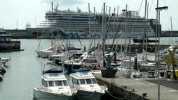 Portugal Madeira island Funchal harbor, big AIDA cruise ship behind marina Footage