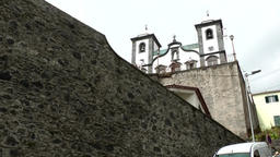 Portugal Madeira church and traditional toboggan men of Monte village Footage