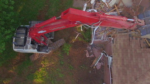 Above Excavator Bucket Puncturing Roof of House ビデオ