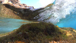 Underwater, waves over rock, slow motion Footage
