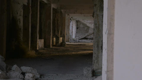 A ruined hallway and staircase from damage during an earthquake with crumbling b Footage