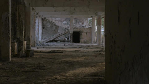 A creepy abandoned building with a crumbling staircase from a major earthquake a Footage