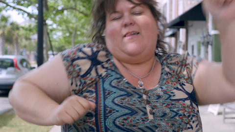 Extremely happy beautiful overweight plus sized woman celebrating success achiev Live Action