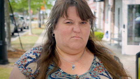 Pissed off angry mad bothered attractive obese woman standing outside giving the Footage