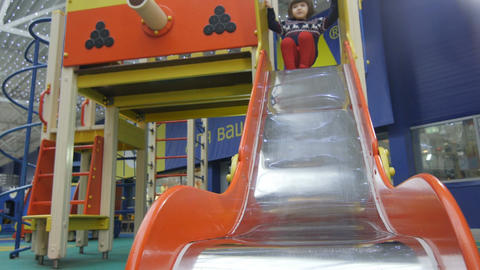 Bottom View Little Girl Slides Off Children Hill on Playground Footage