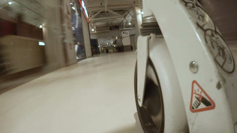 Bottom View Supermarket Trolley Wheel Moves along Store Footage