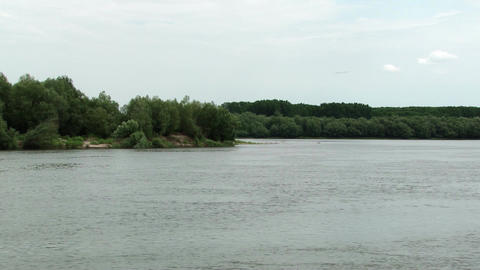 River With Crystal Clear Water. In The Distance, On The River, See A Dense Fores stock footage