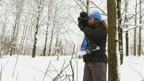 Photographer Taking Pictures In Winter Forest Footage