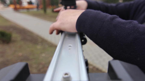 Videographer uses a slider during a filming in park Live Action