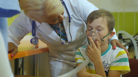 Slow Motion Kind Woman Doctor Treats Little Boy with Inhalation Footage