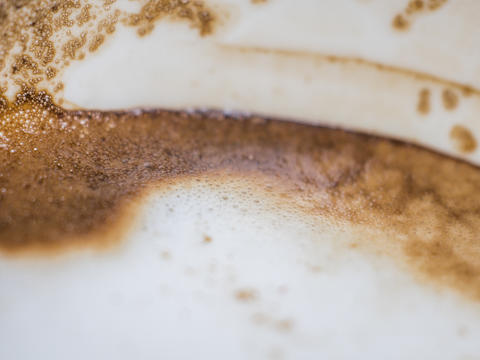Coffee froth and coffee stain on white cup フォト