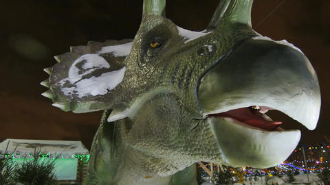 Drone Shows Dinosaur Sculpture Head with Opening Mouth in Park Footage