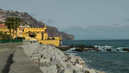 Portugal Madeira Funchal shore with groins and the yellow fortress Footage