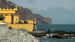 Portugal Madeira yellow fortress of Funchal with groins and the steep coast Footage