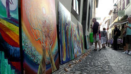 Portugal Madeira art gallery in cobblestone alley of Funchal old town Footage