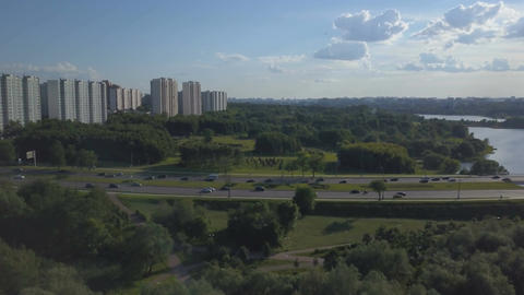 Aerial view of busy road and river and apartment buildings Footage