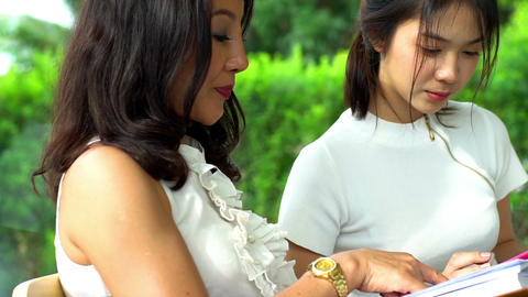 Asian Mother & Teenage Daughter relaxing moment Filmmaterial