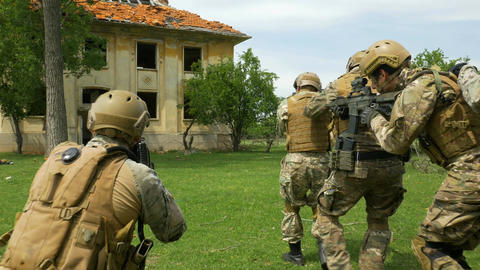 Closeup of military armed soldiers during training exercising in formation takin Footage
