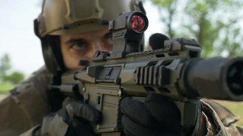 Closeup of special forces soldier watching his target preparing to fire Footage